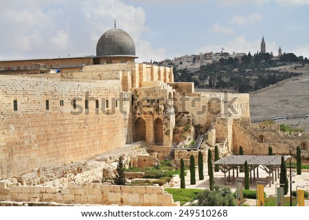 Gray dome of the Al-Aqsa Mosque on the Temple Mount in Jerusalem. The ancient walls of Jerusalem, lit morning sun.