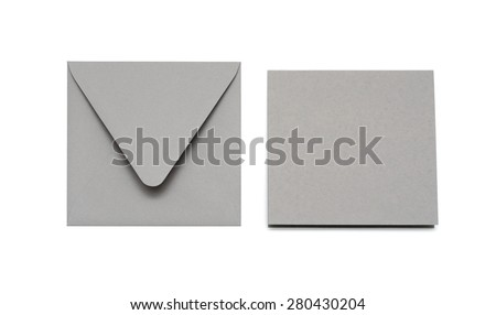 Gray envelope and card on white with shadow - stock photo
