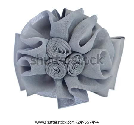 Gray fabric flower isolated on white background - stock photo