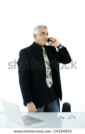Gray haired mature businessman calling on mobile phone, smiling, isolated on white background.