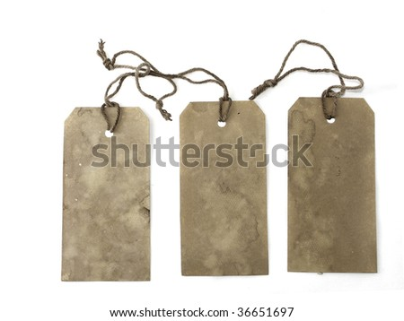 Gray hand stained tags with strings
