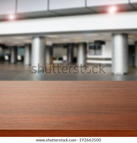 gray interior of airport and brown desk  - stock photo