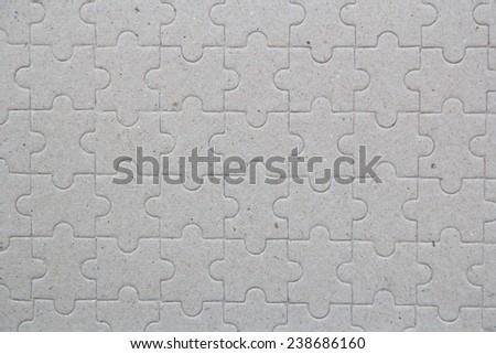 Gray jigsaw puzzle background - stock photo