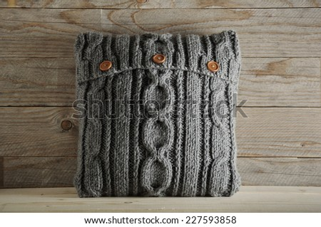 gray knitted pillow pattern - stock photo
