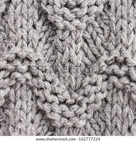 Gray  knitting background texture. Knit woolen Fabric textile multicolor back. - stock photo