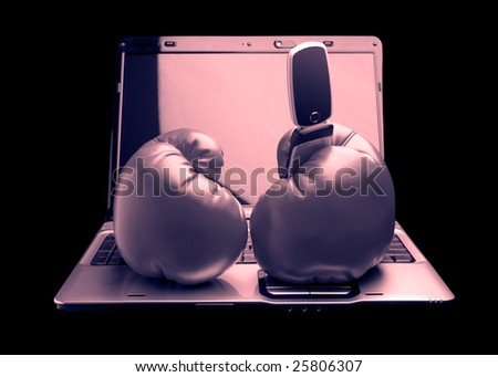Gray laptop with red boxing gloves and black phone - stock photo
