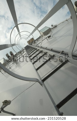Gray metal stairway to top of battle ship deck - stock photo