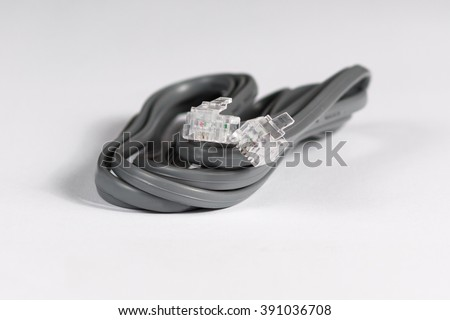 Gray modem cable on white background - stock photo