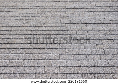 Gray pavement texture background close up