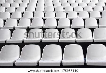 Gray plastic chairs at thetribune football stadium - stock photo