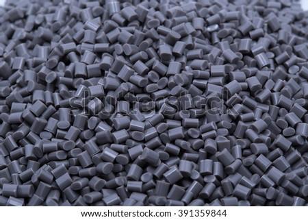 Gray plastic polymer granules.
