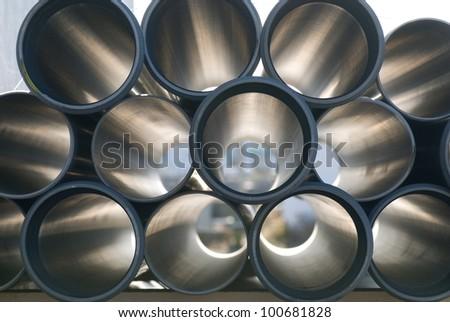 gray PVC tubes plastic pipes - stock photo