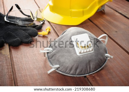 gray respiratory safety on wooden plank - stock photo