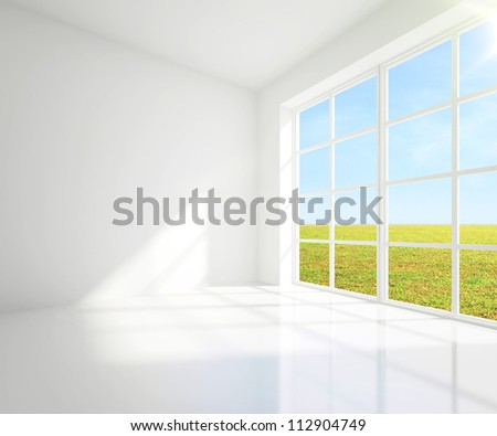 gray room with a view of field from window