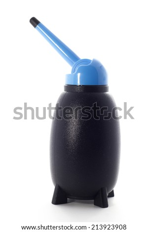 Gray rubber air blower pump dust cleaner isolated on white background - stock photo