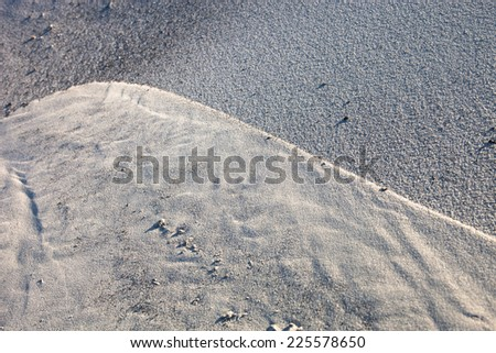 Gray sand surface with rich and various texture - stock photo