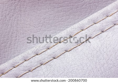Gray sewed leather texture. - stock photo
