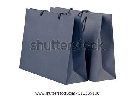 Gray shopping bags on white. - stock photo