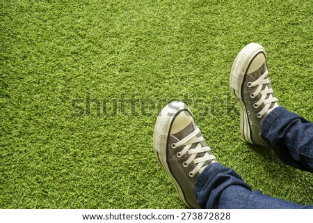 Gray sneakers on the lawn