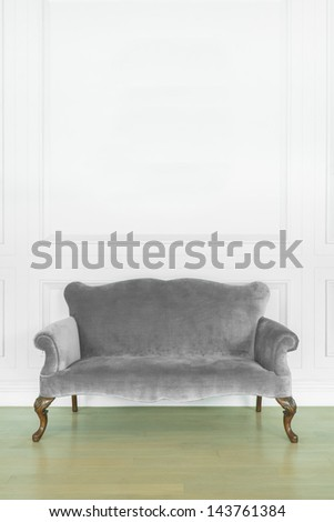 gray sofa in cozy room - stock photo