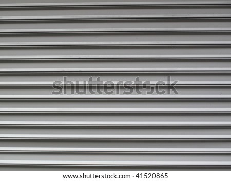 Gray steel garage door with horizontal lines - stock photo