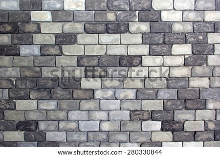 Gray stone brick wall with for background - stock photo