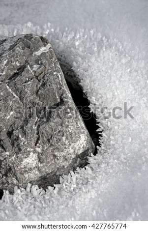 gray stone with snow and ice