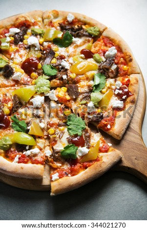 gray; table; metal; pizza; mexican; sweet; corn; parsley; bell; pepper; meat; chunk; cut; wood; board