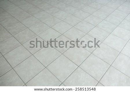 gray tiled floor background - stock photo