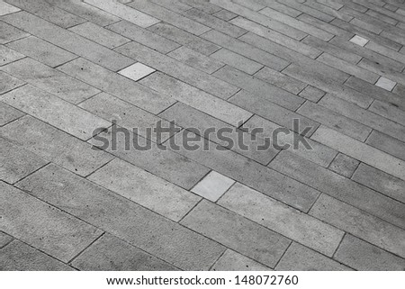 Gray tiled pavement background texture - stock photo