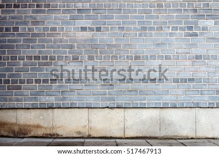 Gray tiled wall with a blank gray bricks