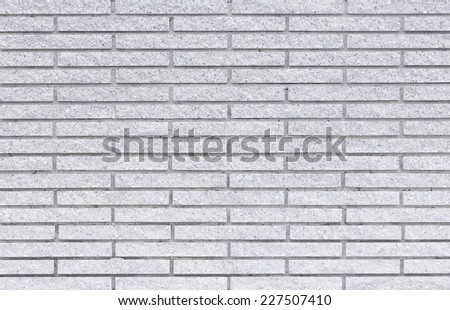 Gray tiles brick wall texture background.