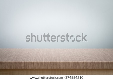 gray wall background  and free space for you and desk space - stock photo