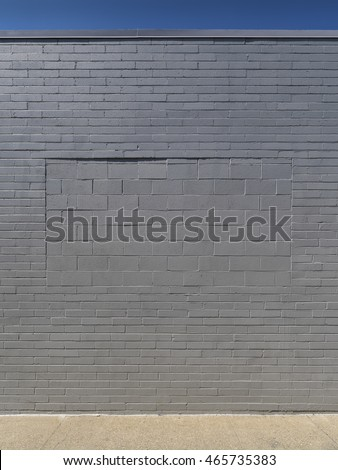 Gray Wall - Cinder Block-Filled Window