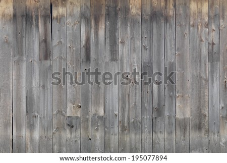 Gray weathered wooden wall texture background - stock photo