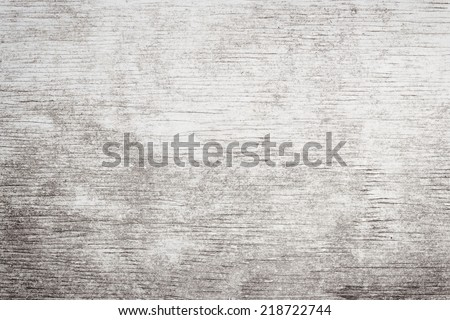 Gray wooden background of weathered distressed rustic wood with faded white paint showing woodgrain texture - stock photo