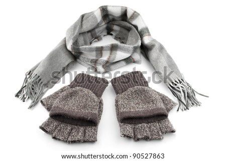 Gray woolen knitted gloves and scarf isolated on white - stock photo