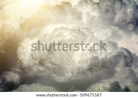 Grayscale clouds with the sun, background