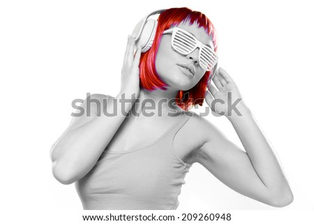Grayscale Young Sexy Woman Having Red Short Hair Listening Music Using Headphones. Isolated White Background - stock photo