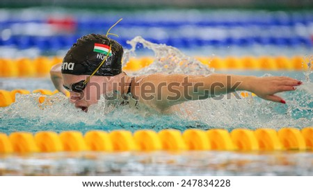 GRAZ, AUSTRIA - APRIL 05, 2014: Adel Juhasz (Hungary) places 2nd in the women's 200m butterfly event in an indoor swimming meeting. - stock photo