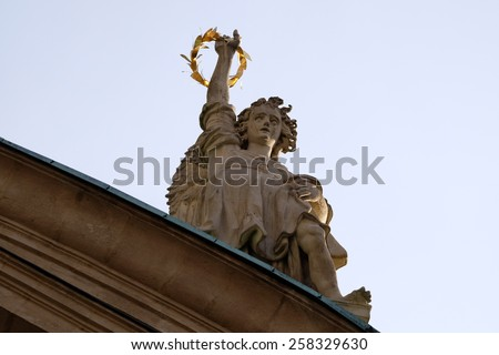 GRAZ, AUSTRIA - JANUARY 10, 2015: Angel on the portal of St. Catherines church and Mausoleum of Ferdinand II, Graz, Austria on January 10, 2015. - stock photo
