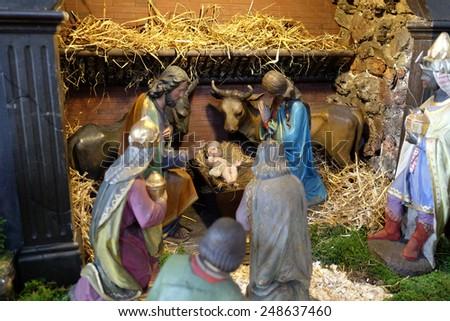 GRAZ, AUSTRIA - JANUARY 10, 2015: Nativity scene, creche, or crib, birth of Jesus in Barmherzigenkirche church in Graz, Styria, Austria on January 10, 2015. - stock photo