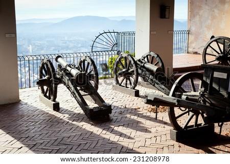 Graz, Austria - January 16, 2011: Old cannon on gun carriage aims to Graz, Austria - stock photo