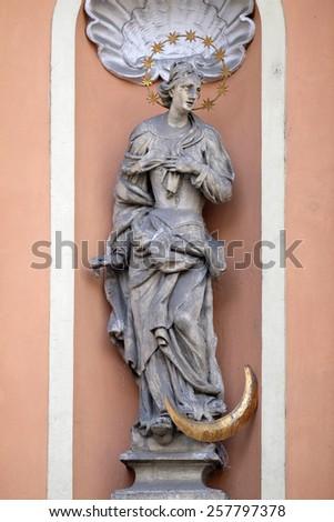 GRAZ, AUSTRIA - JANUARY 10, 2015: Virgin Mary on the portal of Dreifaltigkeitskirche ( Holy Trinity ) church in Graz, Styria, Austria on January 10, 2015. - stock photo