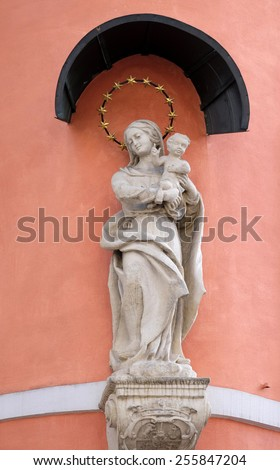 GRAZ, AUSTRIA - JANUARY 10, 2015: Virgin Mary with baby Jesus, statue on the house facade in Graz, Styria, Austria on January 10, 2015. - stock photo
