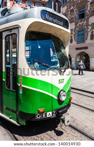 GRAZ, AUSTRIA - JUN 16: Tram on Main Square (Hauptplatz) on June 16, 2011 in Graz, Austria. Tram public tranportation system in Graz operates since 1878 and tram network presently has eight lines.