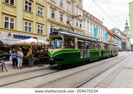 GRAZ, AUSTRIA - JUN 27, 2014: Tramway in  the downtown in Graz, Austria. Graz is the capital of federal state of Styria and the second largest city in Austria