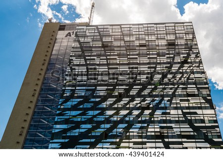 Graz, Austria - June 18, 2016: Façade of the highrise tower of A1 Telekom in Graz, Austria. It hosts the headquarters of A1 Telekom Austria telecommunications company and melts with its surroundings - stock photo