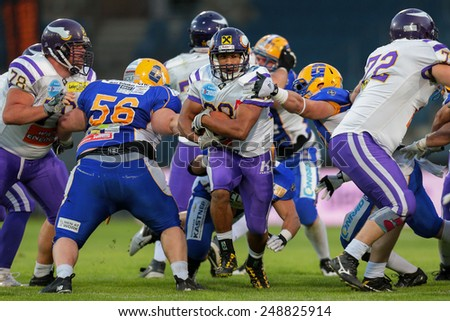 GRAZ, AUSTRIA - JUNE 29 RB Jesse Lewis (#28 Vikings) runs with the ball at the playoffs of the AFL on June 29, 2013 in Graz, Austria. - stock photo