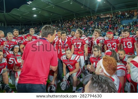 GRAZ, AUSTRIA - MAY 31, 2014: Head Coach Jakob Dieplinger (Austria) talks to his team in the huddle after the  game. - stock photo